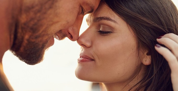 man and woman looking into each other's eyes