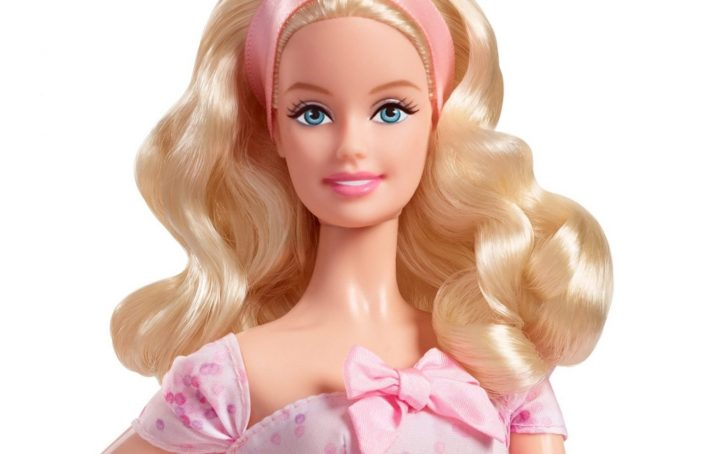 head shot of a blonde barbie doll