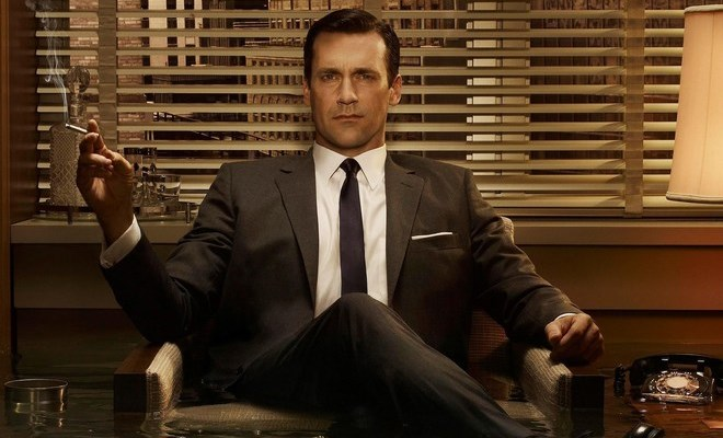 don draper sitting in a confident position