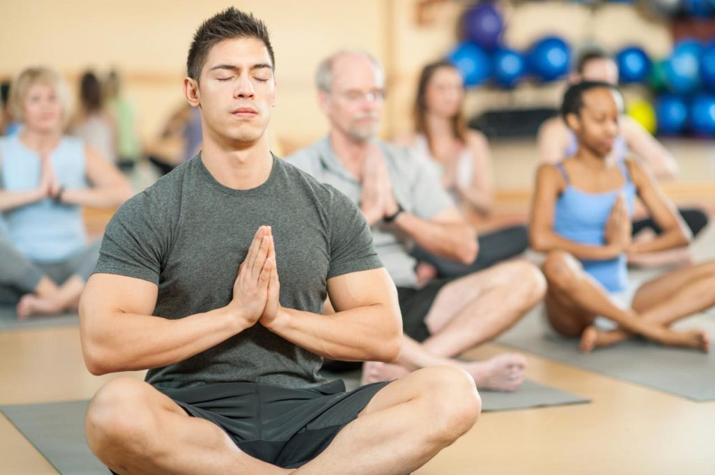man trying out yoga