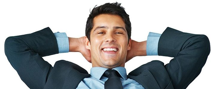 man leaning back relaxed with his hands behind his head