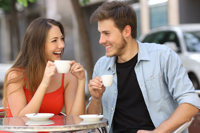 man and woman interested in each other drinking coffee