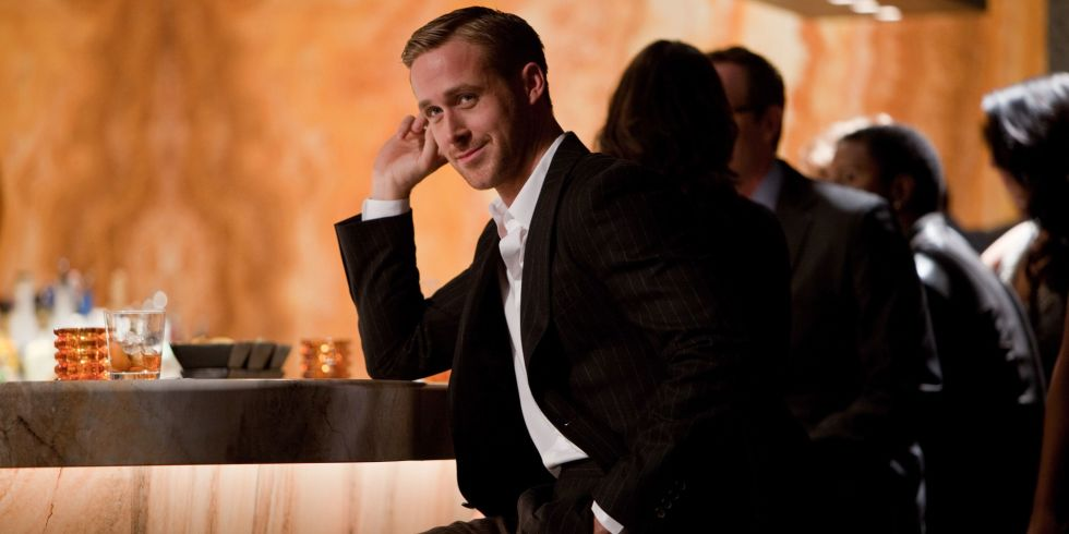 ryan gossling in crazy stupid love leaning on a bar