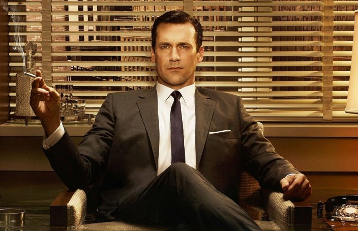 don draper sitting in a chair