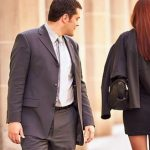 man looking at redhead woman as she walks away