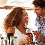 man charms a woman at a bar
