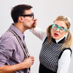 man leans in for kiss and woman stops him